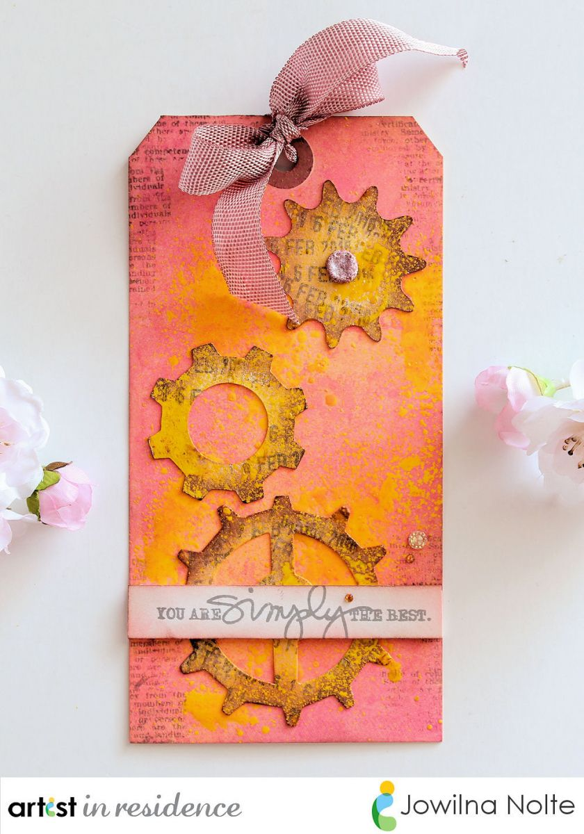 Handmade decorative tag featuring Radiant Neon Ink colors, gear images and a matching ribbon by Jowilna Nolte.