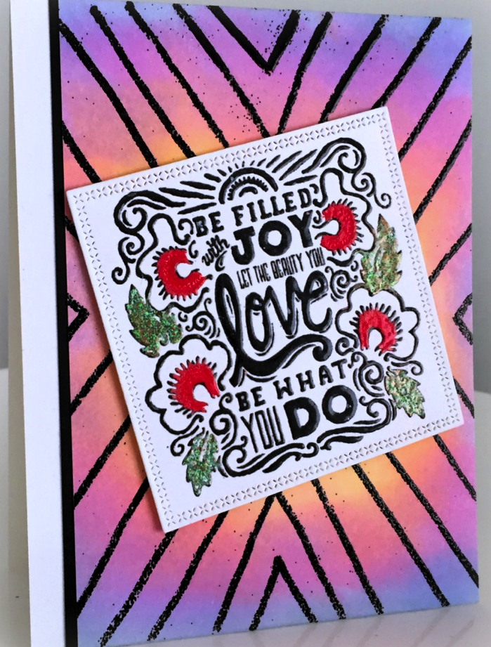 Striking look acheived by embossing a simple hand drawn pattern in black over a colorful background created with a Kaleidacolor inkpad by Martha Lucia Gomez.