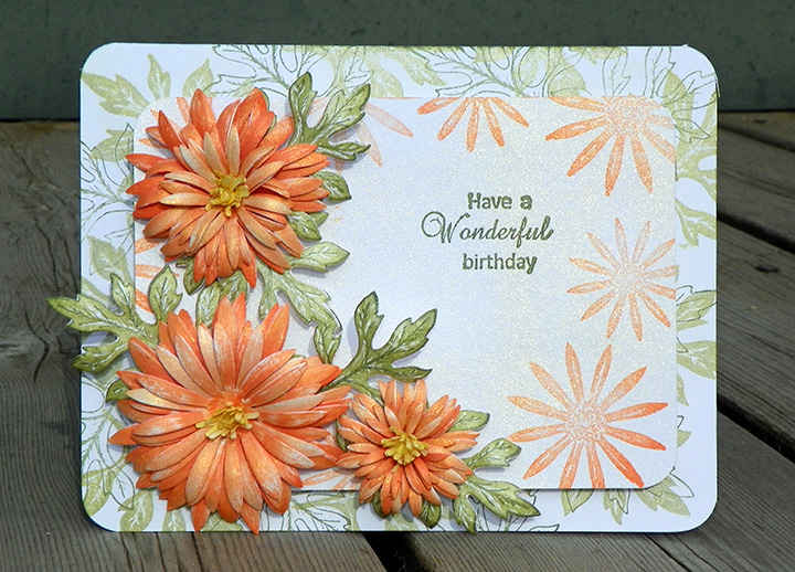 3D handmade card featuring delicate orange flowers and a sparkle added with a Sheer Shimmer spray.