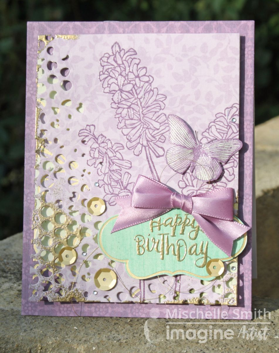 Mischelle Smith uses VersaMark to emboss several different areas of this beautiful handmade birthday card.