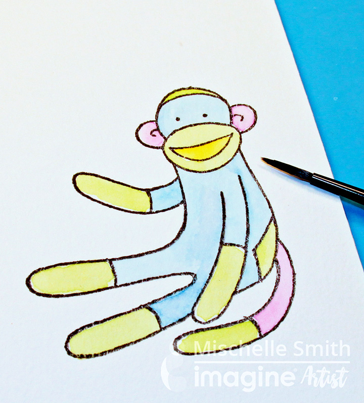 A sock monkey image was stamped in StazOn Jet Black and watercolored in by Mischelle Smith.