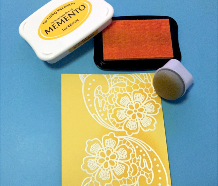 Martha Lucia Gomez carefully blends Memenot Dandelion ink onto a card front with the help from a Jumbo Sponge Dauber.