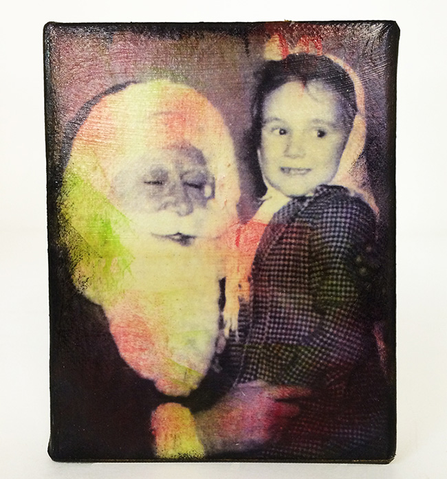 Creative Medium was used to do a toner transfer of a vintage christmas image onto a canvas.
