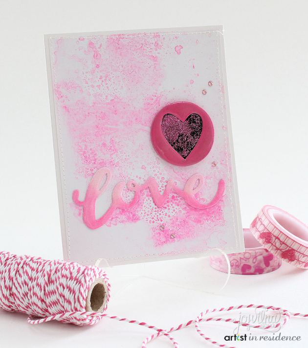irRESISTible Texture Spray was used to make a textured pink background for this handmade Valentine by Jowilna Nolte.