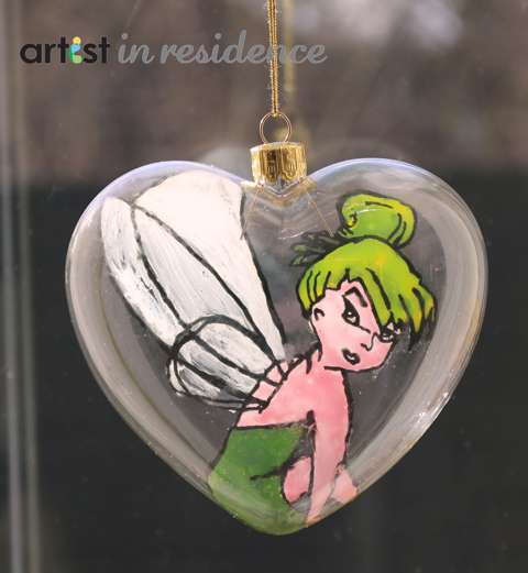 A handmade Tinkerbell inspired glass Christmas ornament made using irRESISTible Pico Embellishers.