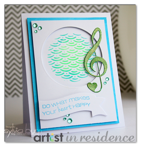 Handmade card featuring blue and green Radiant Neon inks stenciled on in a wave pattern by Sylvia Blum.