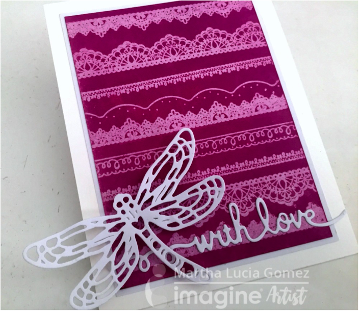 Martha Lucia Gomez creates a fun pattern on her handmade card by stamping lace stamps on glossy cardstock with VersaMark before coloring over creating a ghosting technique.