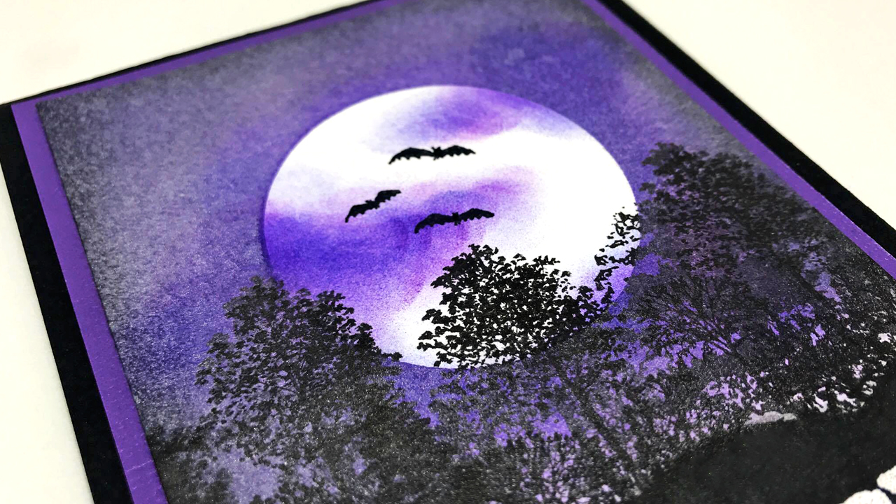 Nadine Carlier handmade card featuring a spooky night sky made by blending Memento Inks and adding a finishing sparkle with Sheer Shimmer.