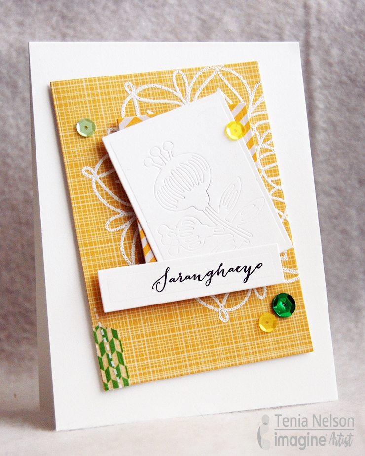 "Handmade card featuring the sentiment ""Saranghaeyo"" which means ""I love you"" in Korean in yellows and greens with embellishments glued down using On Point Glue."