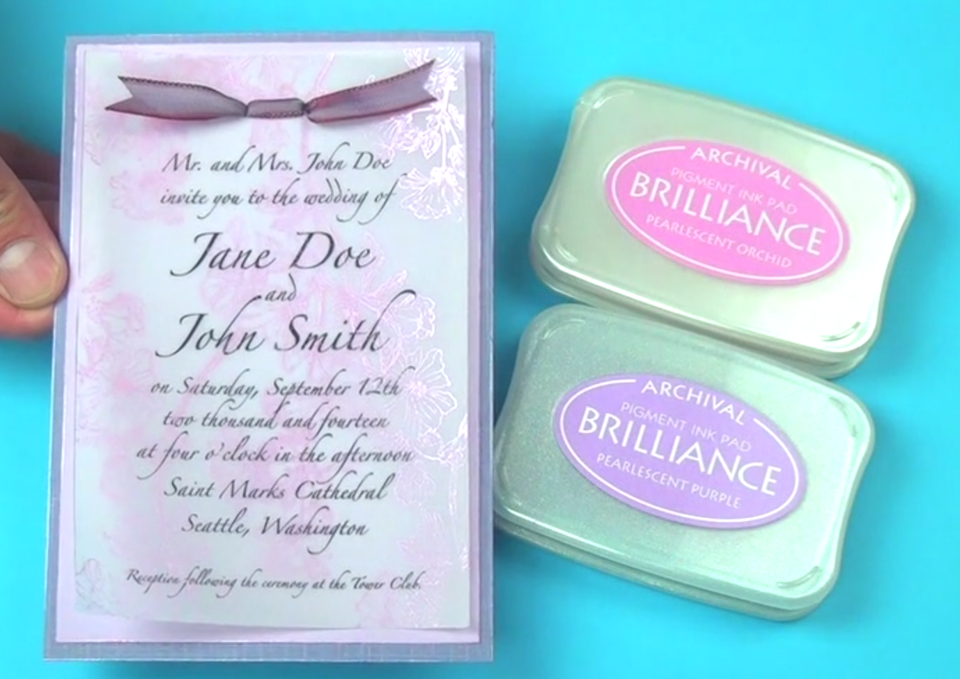 A pink and purple wedding invitation handmade using Brilliance pearlescent pigment inks on vellum.