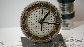 Handmade clock featuring gold embossed numbers.