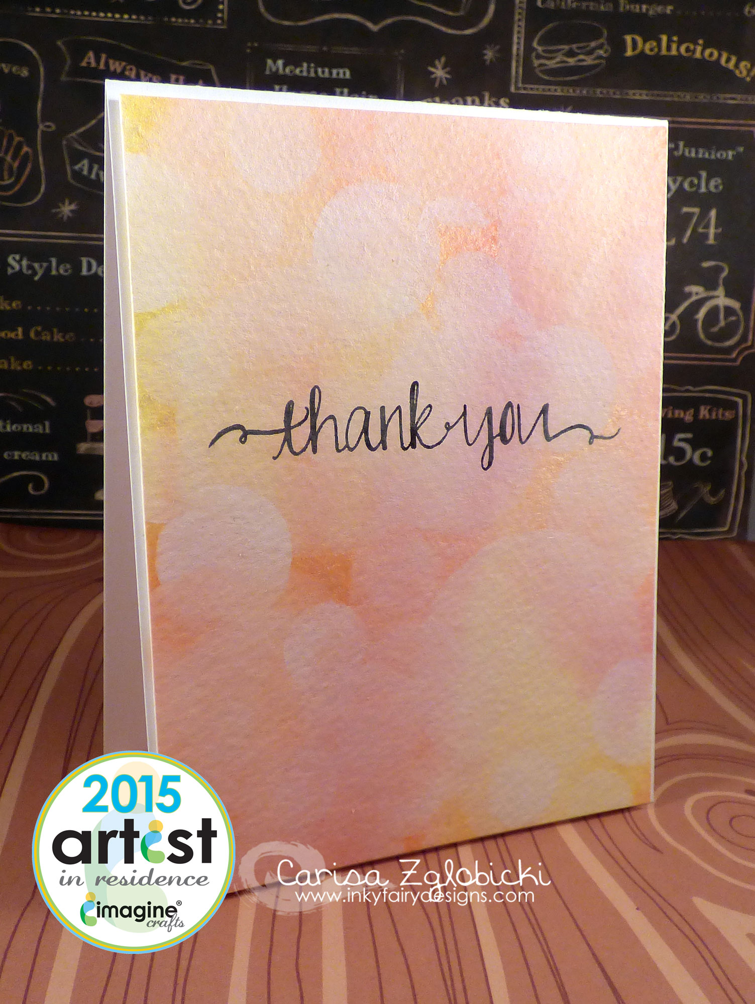 Handmade thank you card featuring a bokeh effect made with inks in yellows, oranges and coral colors.