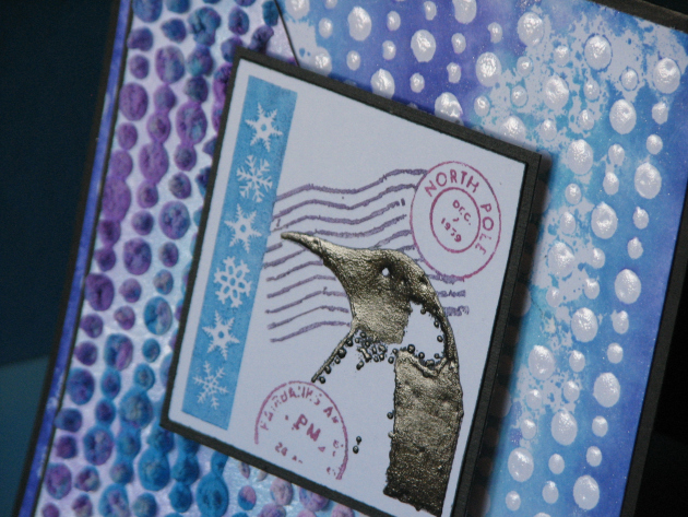 Winter themed card featuing a penguin image, lots of texture elements and snowflakes.