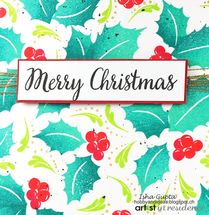A bright and cheery Chrismas card featuring holly images stamped with Kaleidacolor.