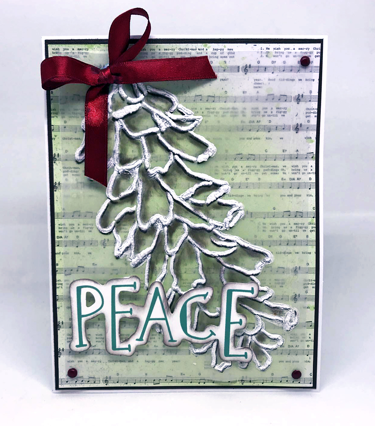 Christmas card featuring a flocked Pinecone created using Radiant Neon Amplify. Using a paper card base and a vellum overlay, Nadine Carlier's Christmas card is a fun yet elegant design.