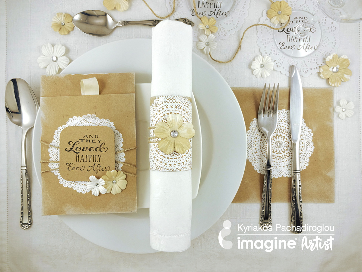 A simple and elegant shabby chic wedding table setting including a napkin ring, menu card holder, cutlery placeholder and glass coasters all with a white doily theme.