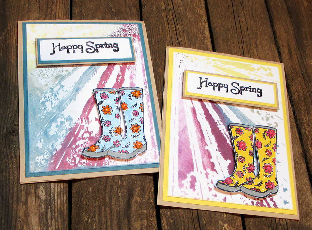 Two spring themed handmade greeting cards featuring rainboot images.