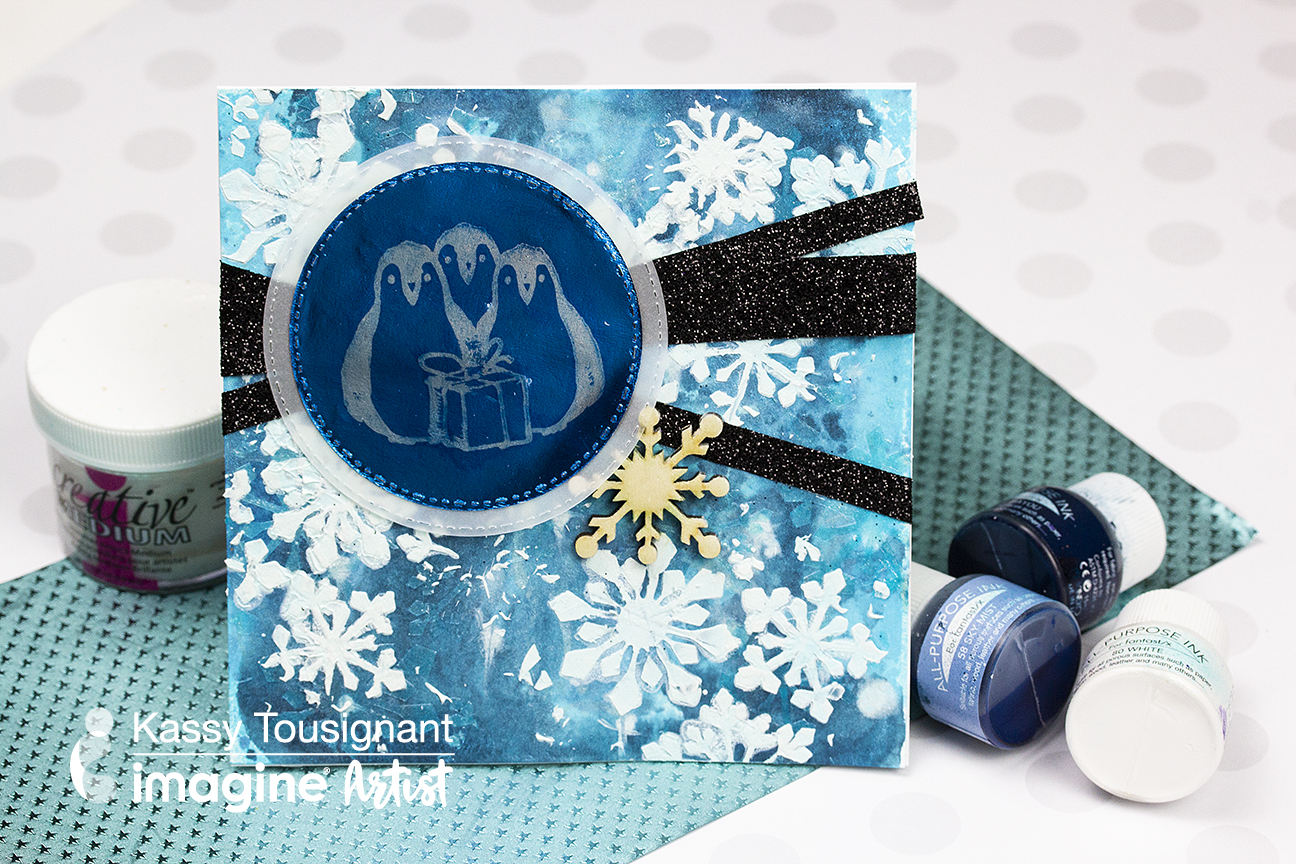 A handmade mixed media style holiday card featuring a penguin image and blue colors.