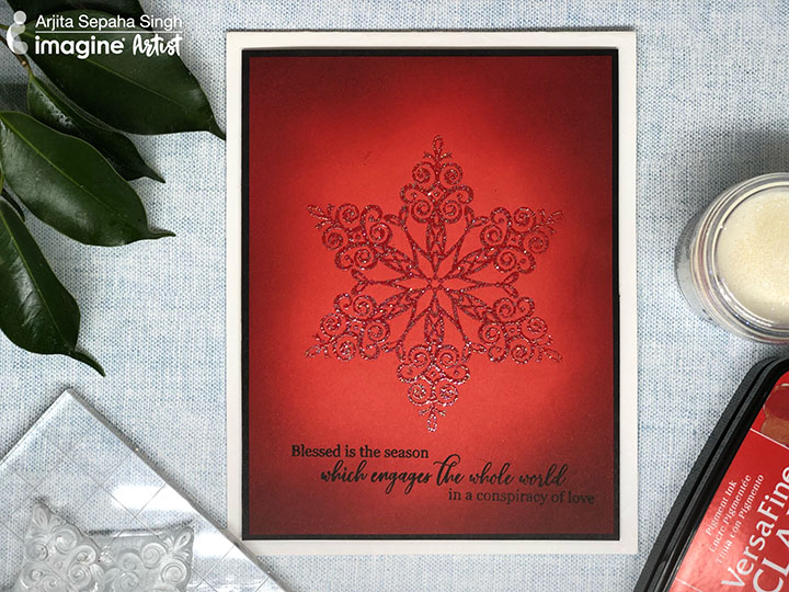 Handmade red snowflake holiday and christmas card.