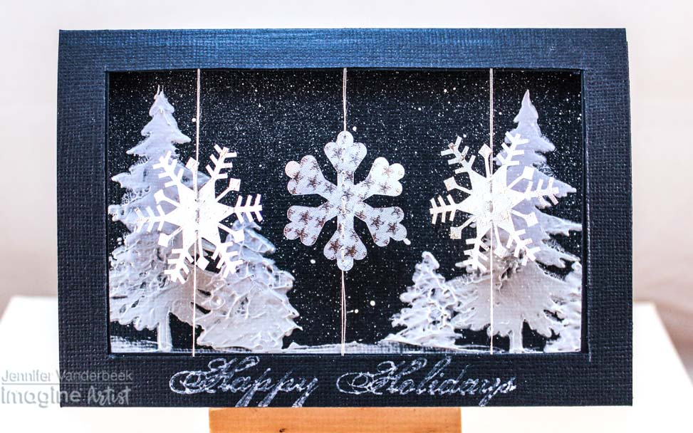 Handmade winter snow themed card featuring spinning snowflakes.