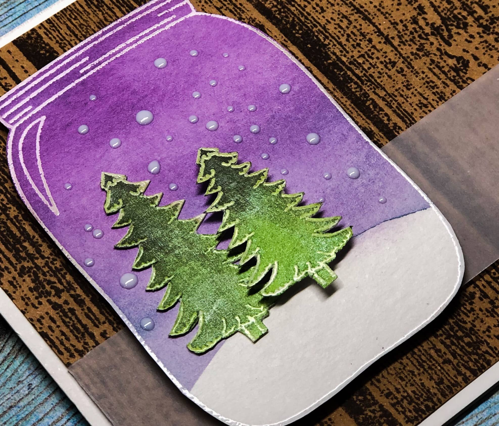 Handmade card featuring a winter tree scene in a mason jar shape.