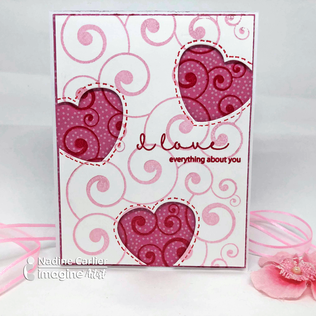 Handmade Valentine card featuring two layers with the same stamp and die cut out hearts using the Dewlet Die cut.