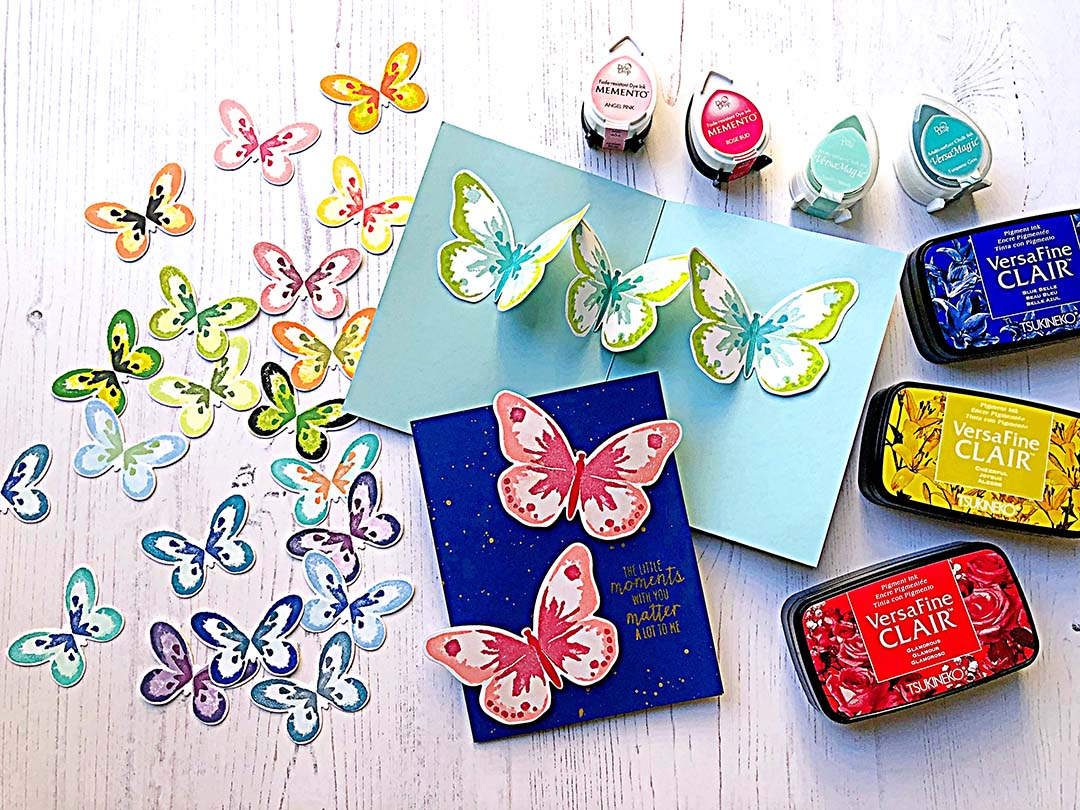 Handmade card featuring layered stamped butterflies that are arranged to create a pop up element inside the greeting card.