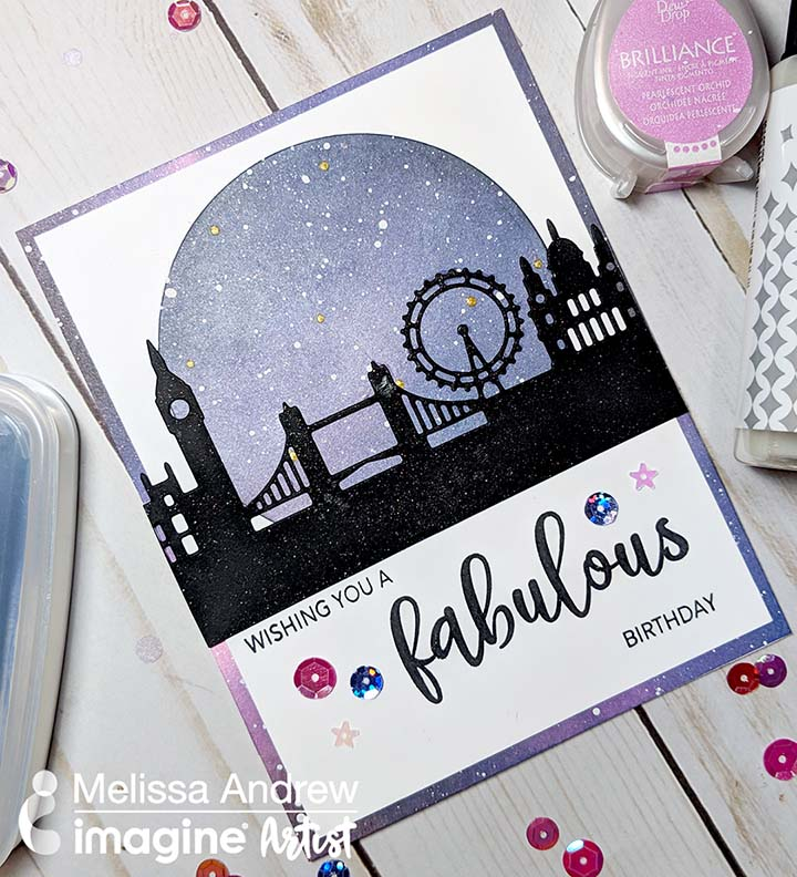 Handmade card featuring a blended night sky background and a London skyline silhouette cut out.