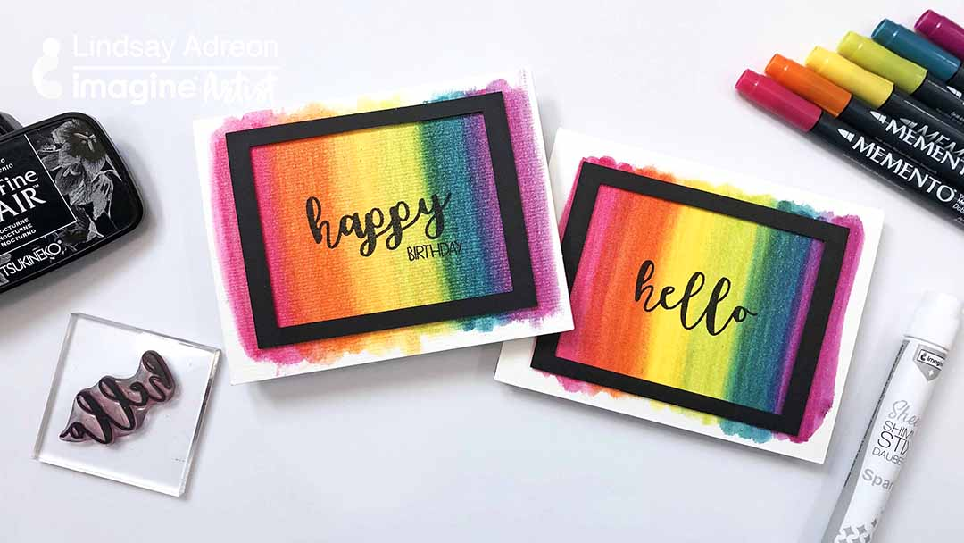 Two handmade cards featuring sparkly rianbow backgrounds made using Memento Markers and Sheer Shimmer Stix.