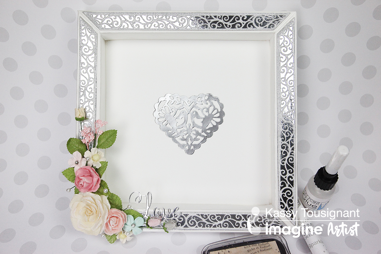 Handmade frame for guests to sign at a wedding in silver and white