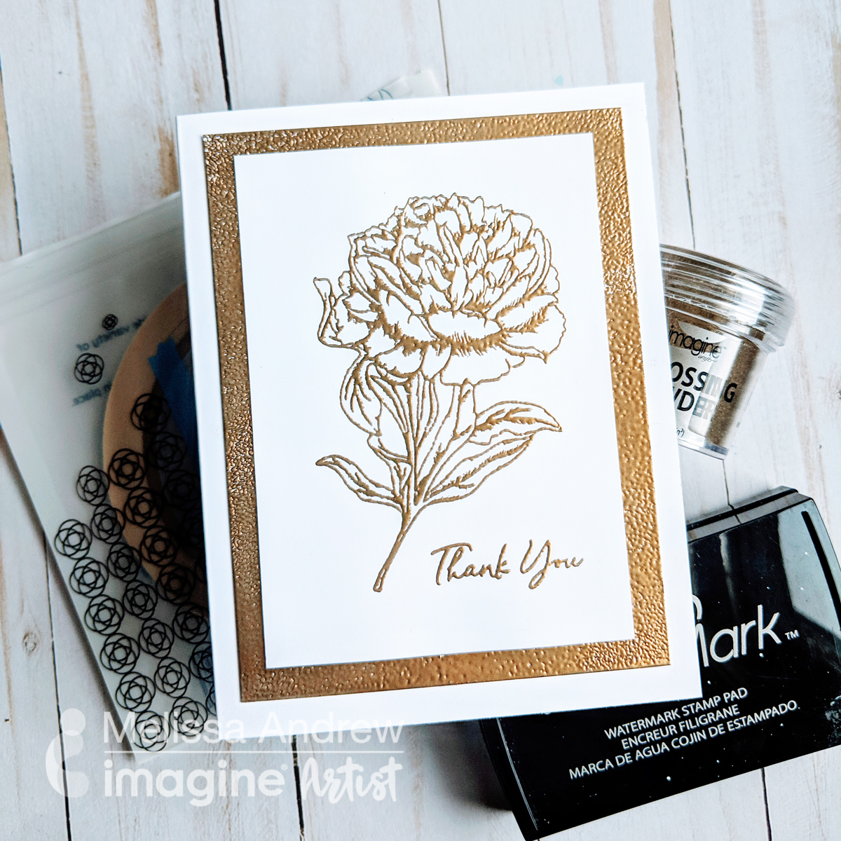 Handmade wedding thank you note featuring gold embossing.