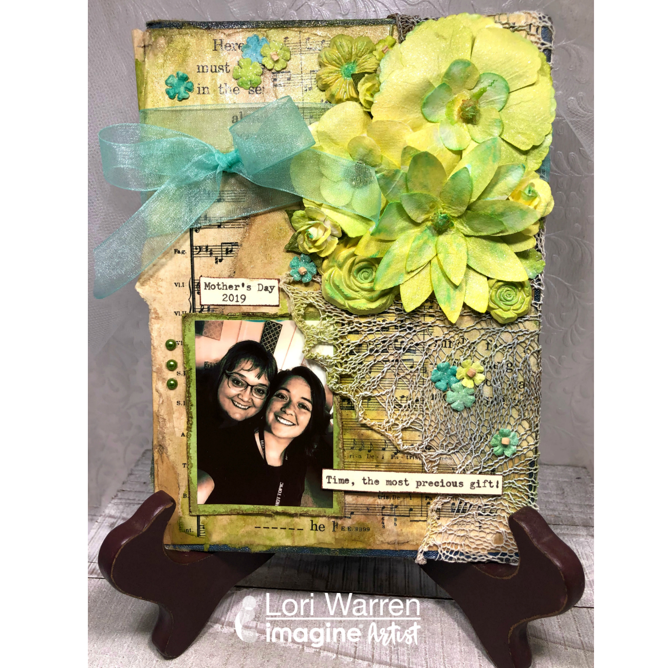 Handmade Mother's Day Memory board in bright greeens made by applying mixed media techniques to a book cover.