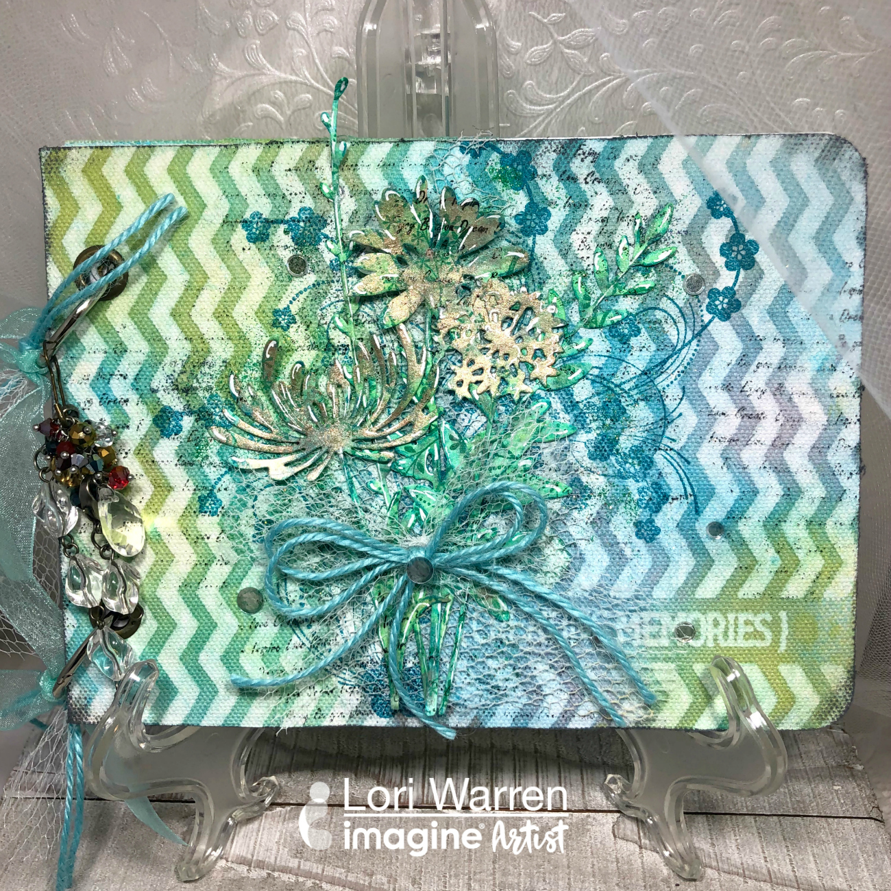 Handmade creative art journal featuring a mixed media cover in blues and greens.