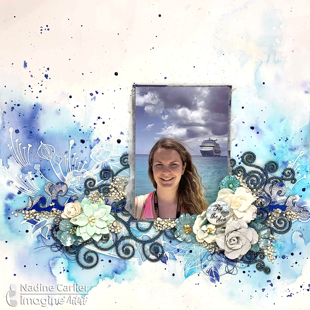 Handmade scrapbook layout featuring blue tones made with Fireworks shimmery craft sprays.