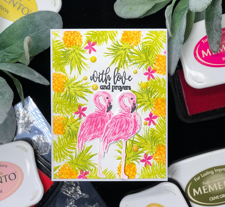 Layered card featuring a flamingo and tropical leaves made using Memento with layering stamps.